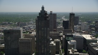 AX36_094 - 5K stock footage aerial video flying by SunTrust Plaza reavealing skyscrapers and hotel, Downtown Atlanta