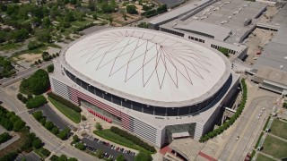 AX36_104 - 5K stock footage aerial video tilting down on Georgia Dome, Downtown Atlanta