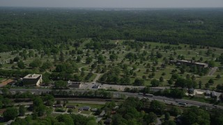 AX37_004 - 5K stock footage aerial video approaching a cemetery, Atlanta, Georgia