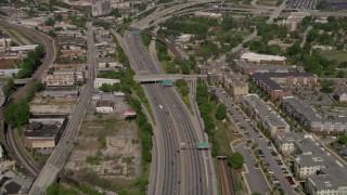AX37_010 - 5K stock footage aerial video following freeway revealing Downtown Atlanta, Georgia