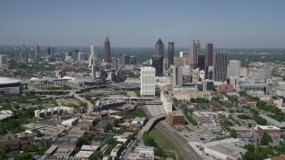 AX37_011 - 5K stock footage aerial video approaching Midtown skyscrapers with Downtown Atlanta in the distance, Georgia