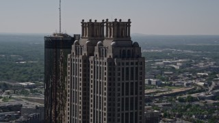 AX37_015 - 5K stock footage aerial video orbiting the top of 191 Peachtree Tower, Downtown Atlanta