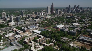 AX37_034 - 5K stock footage aerial video flying by Georgia Institute of Technology toward Midtown Atlanta skyscrapers, Atlanta, Georgia