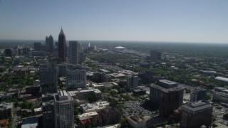 AX37_037 - 5K stock footage aerial video flying by Midtown Atlanta skyscrapers revealing Downtown, Georgia