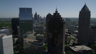AX37_040 - 5K stock footage aerial video of a medium shot flying by Midtown Atlanta skyscrapers, Georgia