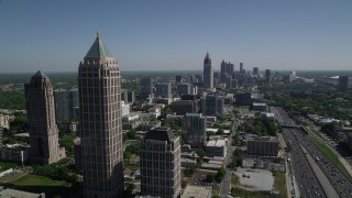 AX37_041 - 5K stock footage aerial video of Midtown Atlanta skyscrapers and office buildings along Downtown Connector, Georgia