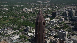 AX37_048 - 5K stock footage aerial video of the top of Bank of America Plaza revealing wooded area, Midtown Atlanta, Georgia