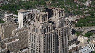 AX37_054 - 5K stock footage aerial video orbiting 191 Peachtree Tower, revealing Westin Peachtree Plaza, Downtown Atlanta