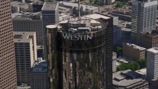 AX37_059 - 5K stock footage aerial video orbiting top of Westin Peachtree Plaza Hotel, Downtown Atlanta