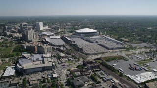 AX37_075 - 5K stock footage aerial video tilting up from elementary school and residential neighborhood revealing Georgia Dome