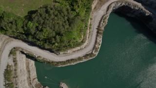 AX37_087 - 5K stock footage aerial video approaching a quarry and tilt down to bird's eye, Atlanta, Georgia