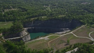 AX37_088 - 5K stock footage aerial video flying by a quarry, Atlanta, Georgia