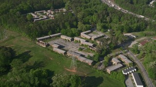 AX38_001 - 5K stock footage aerial video orbiting abandoned buildings, Atlanta, Georgia