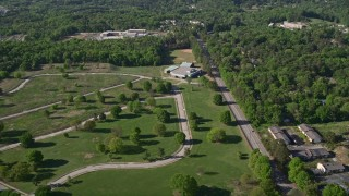 AX38_002 - 5K stock footage aerial video flying by a rural elementary school nestled among trees, Atlanta, Georgia
