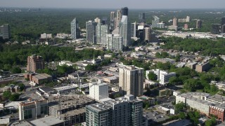 AX38_012 - 5K stock footage aerial video approaching skyscrapers overlooking forests, Buckhead, Georgia
