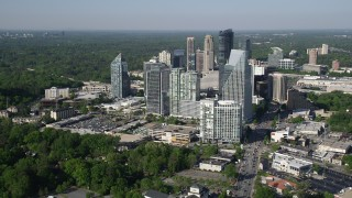 AX38_013 - 5K stock footage aerial video approaching skyscrapers and Terminus Atlanta, Buckhead, Georgia