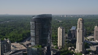 AX38_015 - 5K stock footage aerial video orbiting 3344 Peachtree Road skyscraper, Buckhead, Georgia