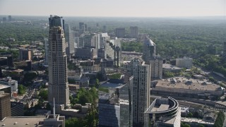 AX38_018 - 5K stock footage aerial video tilting down from skyscrapers to Marsh Mercer building, Buckhead, Georgia
