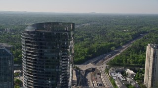 AX38_019 - 5K stock footage aerial video approaching and orbiting 3344 Peachtree skyscraper, Buckhead, Georgia