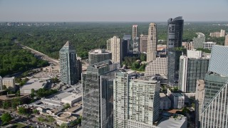 AX38_021 - 5K stock footage aerial video approaching skyscrapers and tilting down on an office building, Buckhead, Georgia