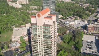 AX38_024 - 5K stock footage aerial video of a medium shot of Park Avenue Condos revealing skyscrapers, Buckhead, Georgia
