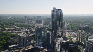 AX38_026 - 5K stock footage aerial video flying by 3344 Peachtree skyscraper and approach Terminus Atlanta, Buckhead, Georgia