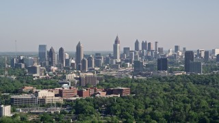 AX38_030E - 5K stock footage aerial video of the Midtown and Downtown Atlanta skyline seen from Buckhead, Georgia