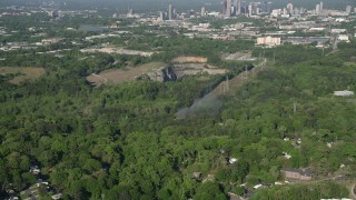 AX38_034 - 5K stock footage aerial video of smoke rising from a house on fire in a wooded neighborhood, West Atlanta