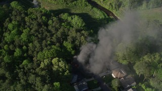 AX38_037 - 5K stock footage aerial video of a bird's eye of smoke from a burning home, West Atlanta, Georgia