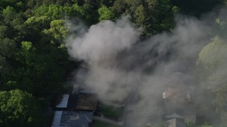 AX38_043 - 5K stock footage aerial video of smoke rising from a burning home, West Atlanta, Georgia