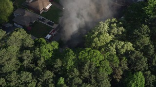 AX38_044 - 5K stock footage aerial video circling above rising smoke from a house fire, West Atlanta, Georgia