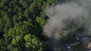 AX38_046 - 5K stock footage aerial video circling a house fire and rising smoke, West Atlanta, Georgia