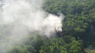AX38_051 - 5K stock footage aerial video of thick smoke rising from a burning home, West Atlanta, Georgia