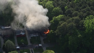 AX38_052 - 5K stock footage aerial video approaching smoke and flames from a burning home, West Atlanta, Georgia