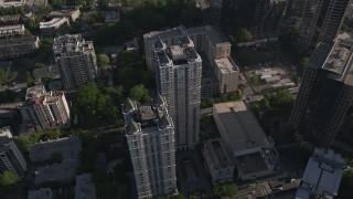 AX38_068 - 5K stock footage aerial video tilting down to bird's eye of condominium complex, Midtown Atlanta