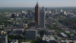 AX38_069 - 5K stock footage aerial video approaching skyscrapers towering over citiy buildings, Midtown Atlanta