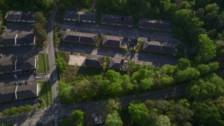 AX38_081 - 5K stock footage aerial video of a bird's eye orbiting abandoned buildings among trees, Atlanta