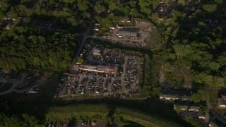 AX39_001 - 5K stock footage aerial video tilting down on a junkyard, West Atlanta, Georgia