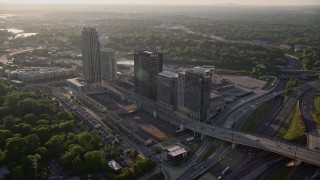 AX39_024 - 5K stock footage aerial video flying away from office buildings and The Atlantic apartments, Midtown Atlanta