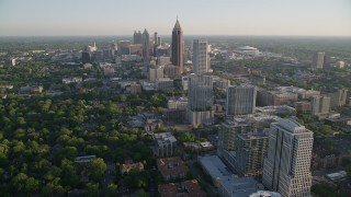 AX39_034 - 5K stock footage aerial video flying by Midtown Atlanta buildings toward Bank of America Plaza, Georgia