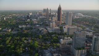 AX39_035 - 5K stock footage aerial video flying by Midtown Atlanta while approaching Bank of America Plaza, Georgia