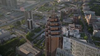 AX39_054 - 5K stock footage aerial video orbiting the top of Promenade II, Midtown Atlanta, Georgia
