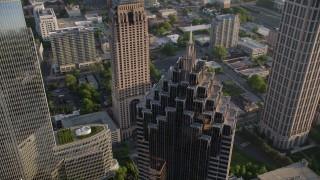 AX39_055 - 5K stock footage aerial video orbiting top of Promenade II, Midtown Atlanta, Georgia