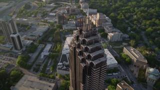 AX39_057 - 5K stock footage aerial video orbiting top of Promenade II, Midtown Atlanta, Georgia