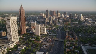 AX39_063 - 5K stock footage aerial video following Downtown Connector toward Downtown skyscrapers, Atlanta