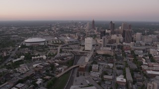 AX40_002 - 5K stock footage aerial video of Midtown and Georgia Dome seen while approaching Downtown, Atlanta, Georgia, twilight