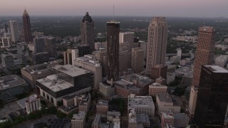 AX40_004 - 5K stock footage aerial video flying over Downtown toward Westin Peachtree Plaza Hotel, Atlanta, Georgia, twilight
