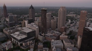 AX40_005 - 5K stock footage aerial video flying by skyscrapers, Downtown Atlanta, Georgia, twilight