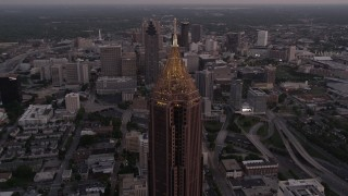 AX40_008 - 5K stock footage aerial video flying by Bank of America Plaza revealing skyscrapers and office buildings, Downtown Atlanta, twilight