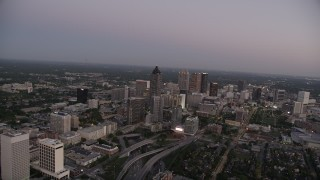 AX40_013 - 5K stock footage aerial video approaching sksycrapers, Downtown Atlanta, Georgia, sunset